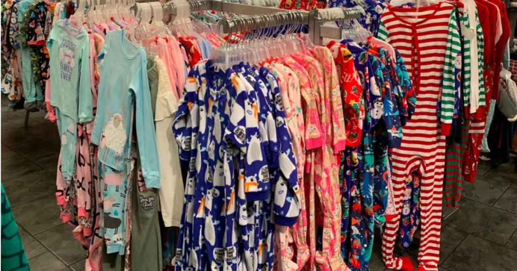 the children's place pajamas hanging on a store rack
