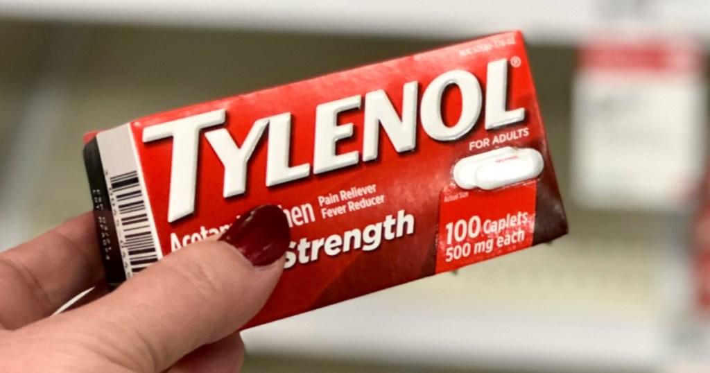 hand holding box of Tylenol