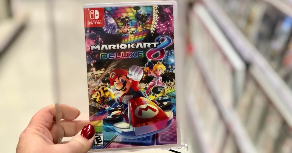 Mario Kart 8 for Nintendo Switch game held in hand