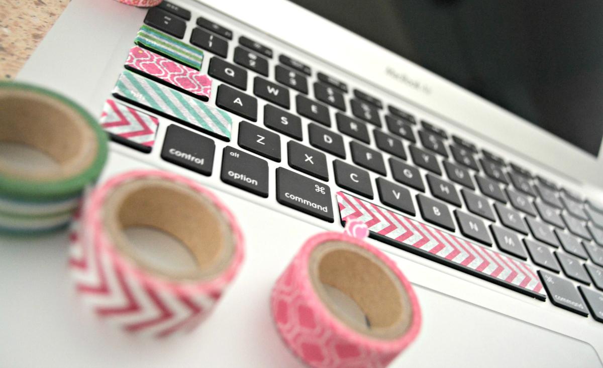 Washi tape embellishments on a laptop keyboard