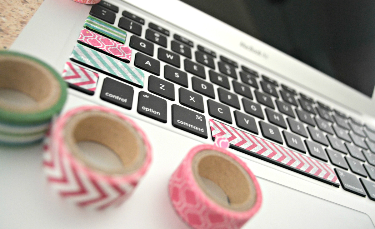Washi tape embellishments on a laptop keyboard
