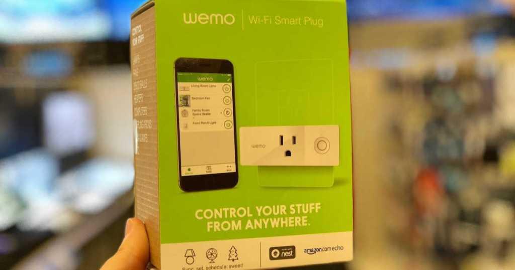 Hand holding Wemo wifi Smart Plug