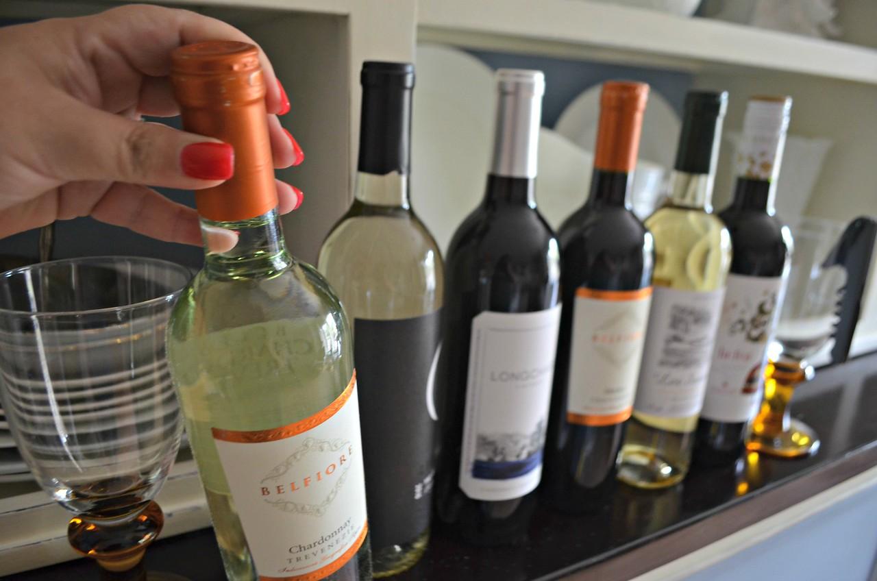 wine bottles in a row on a shelf