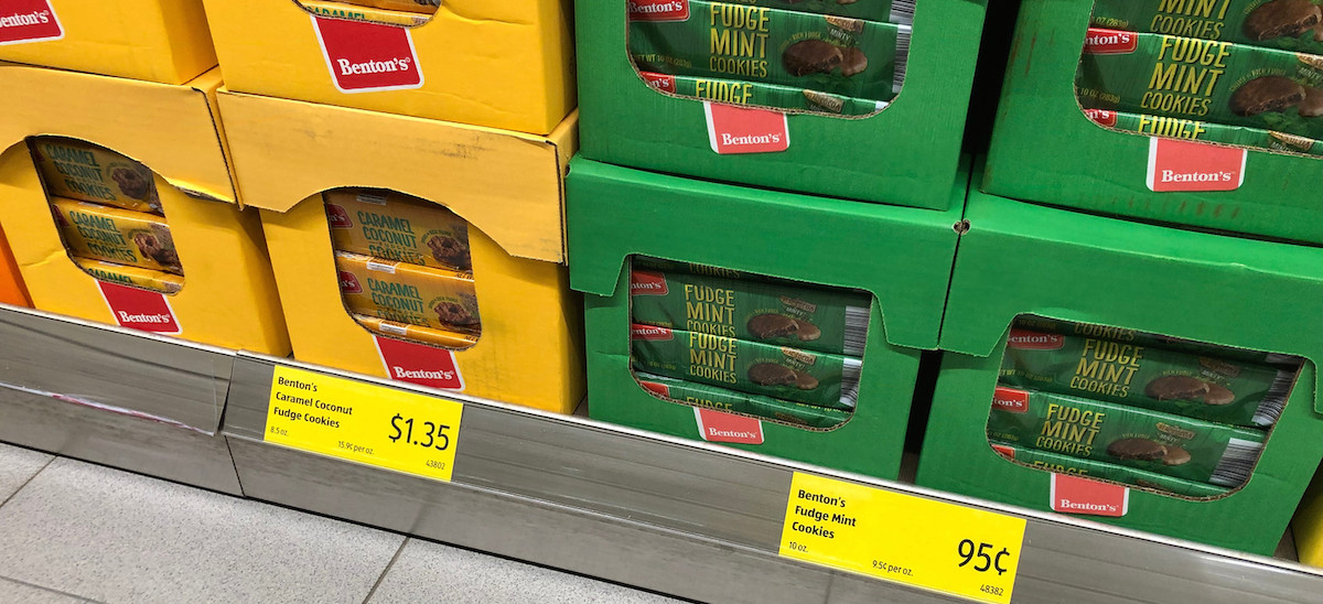 yellow and green stacked cardboard boxes on store shelf full of cookies