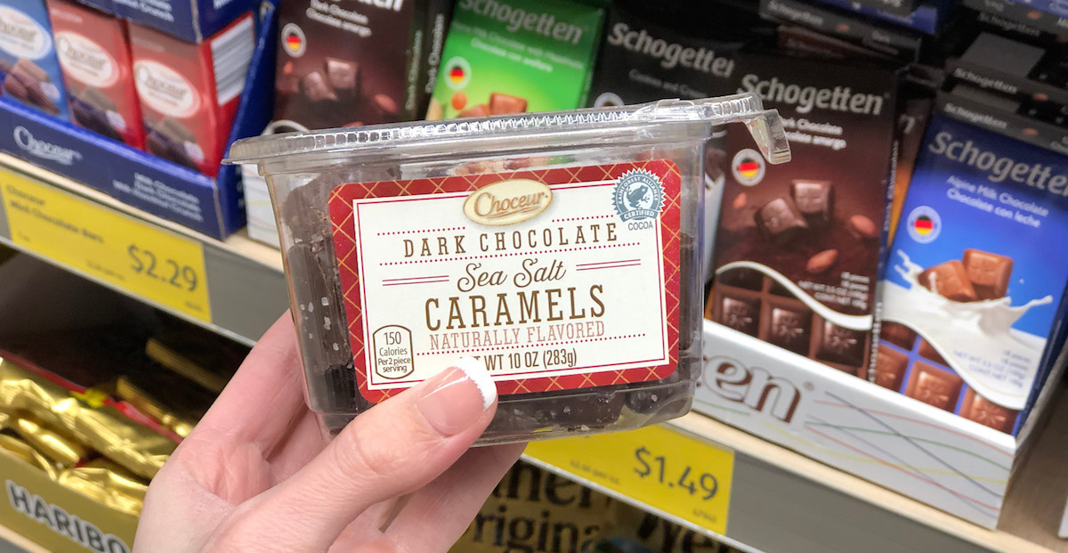 hand holding a box of sea salt dark chocolate caramels