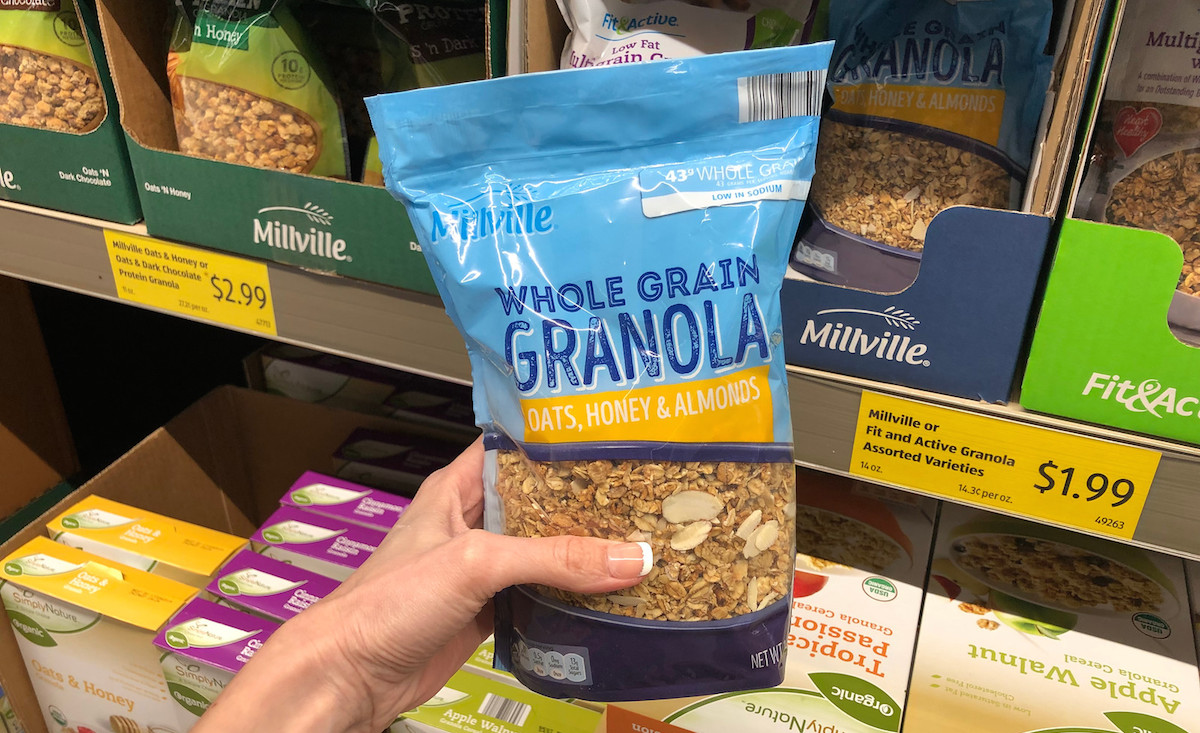 hand holding a bag of whole grain granola