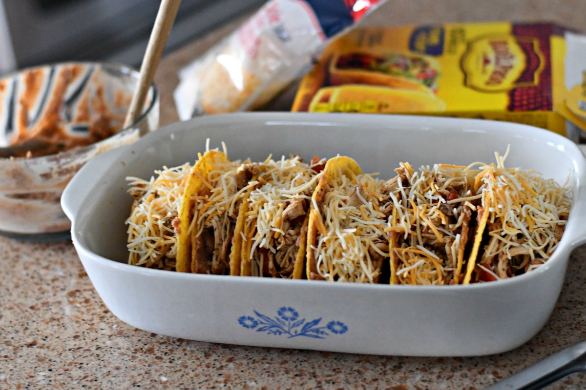 Slow Cooker Chicken Tacos - in shells in a baking dish