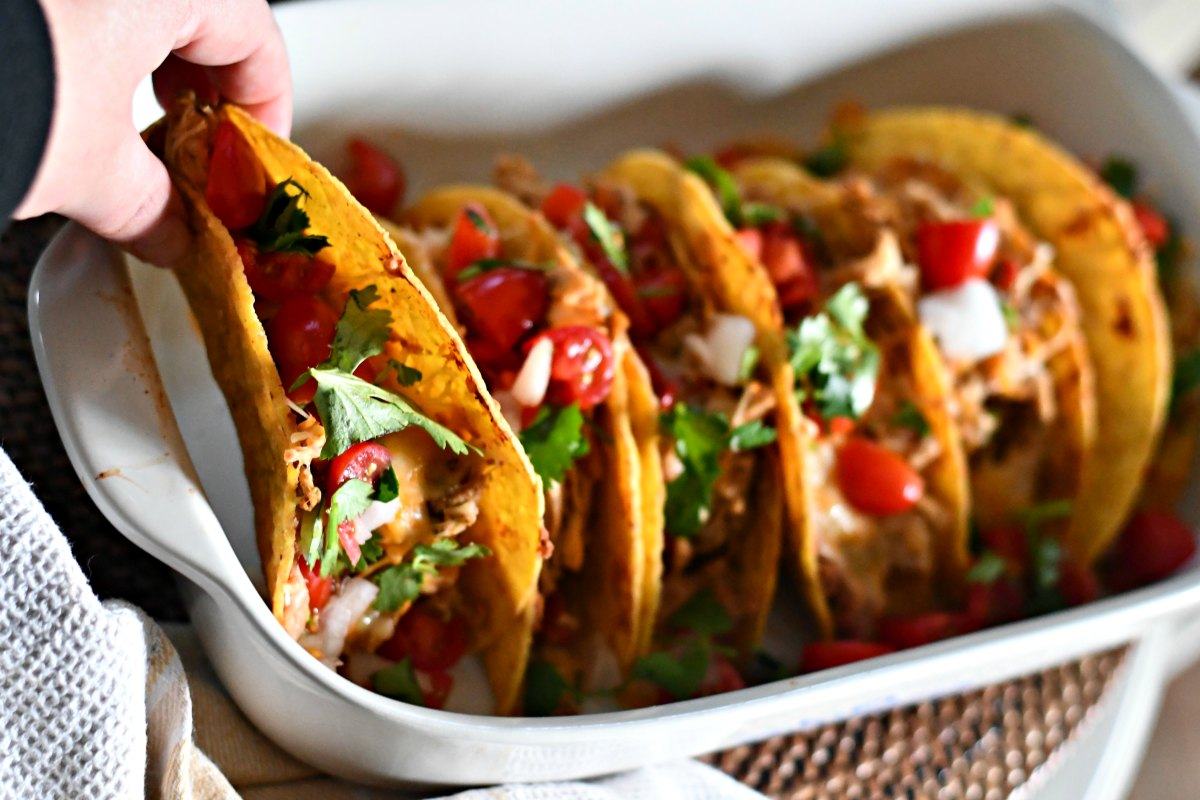 Slow Cooker Chicken Tacos - served up with tomatoes, lettuce, and cilantro