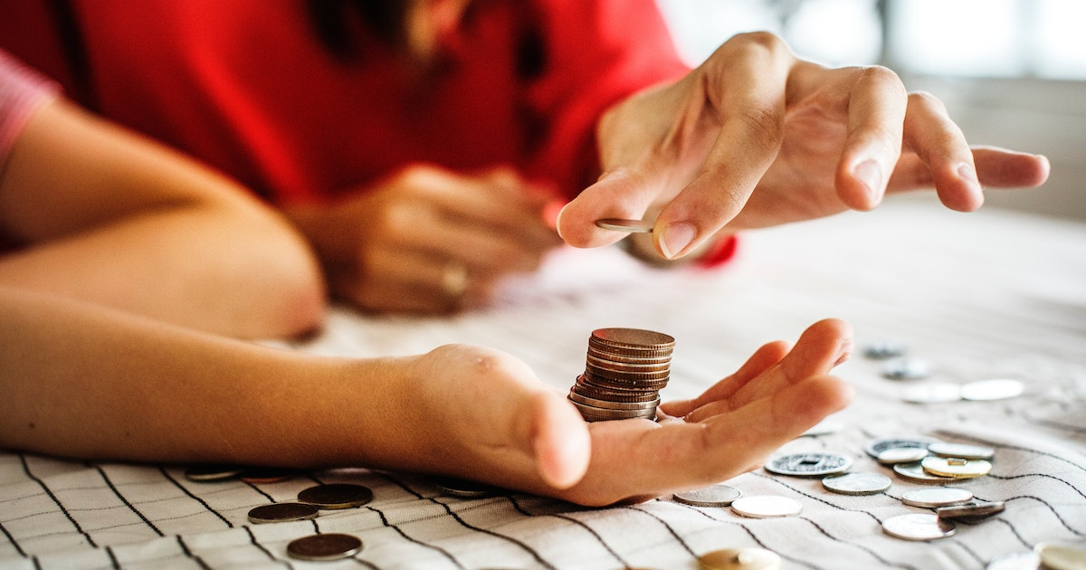 red shirt woman handing man coins money for banking money sharing