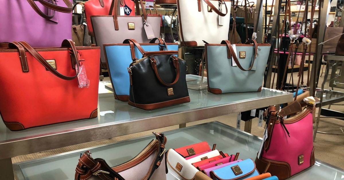 collection of dooney & bourke bags on store display