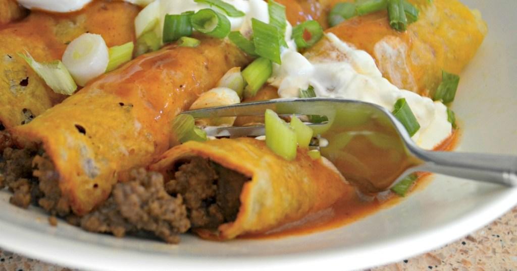 Hip2Keto enchiladas Recipe - up close image of keto enchiladas in a baking dish