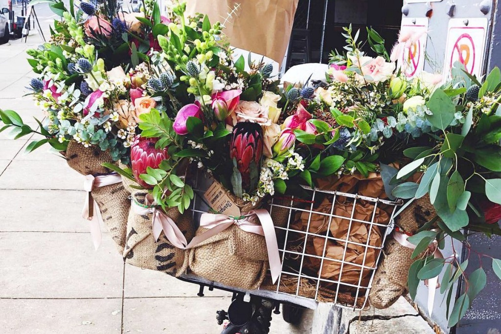 farmgirl flowers bouquets in deliver bike