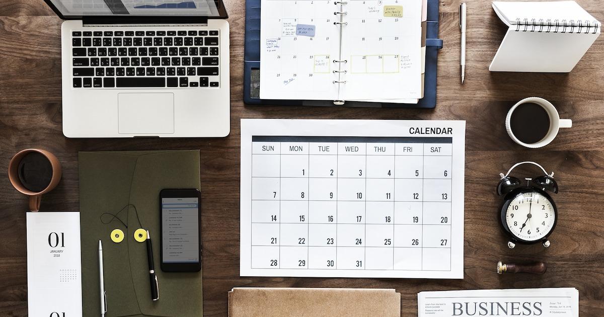calendar laptop planner flatlay meeting prep