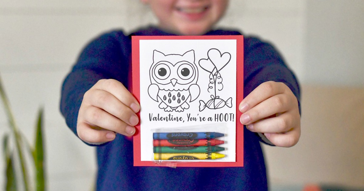 DIY Crayon Valentines (Free Printable Included) – young child holding an example