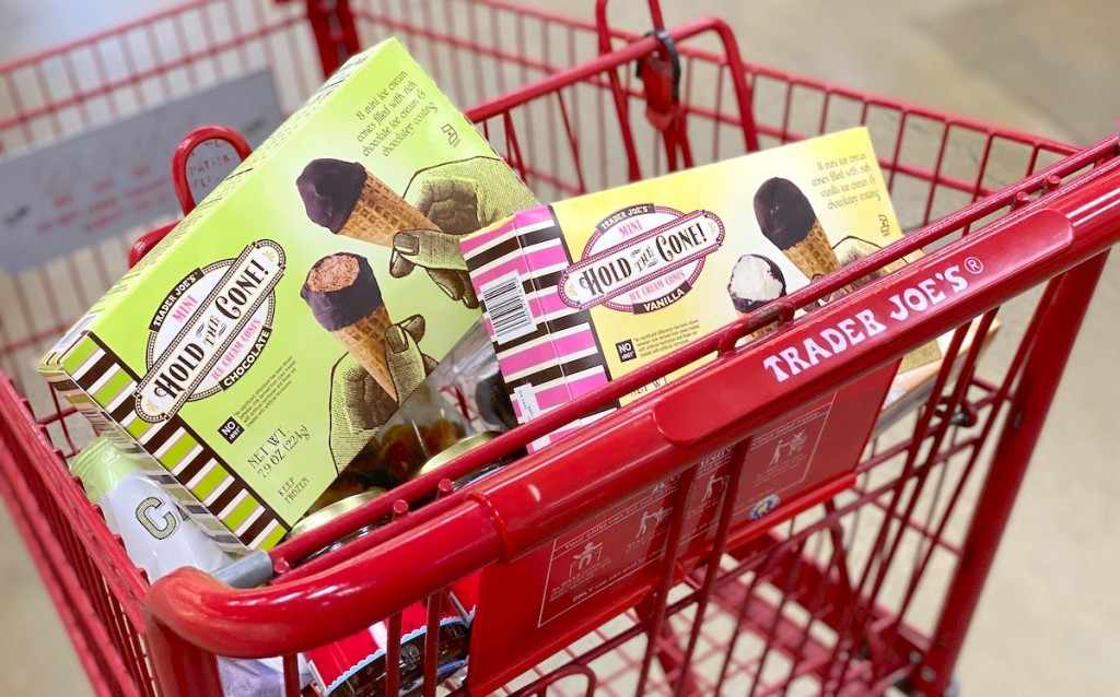 two boxes of ice cream cones in a red trader joes cart