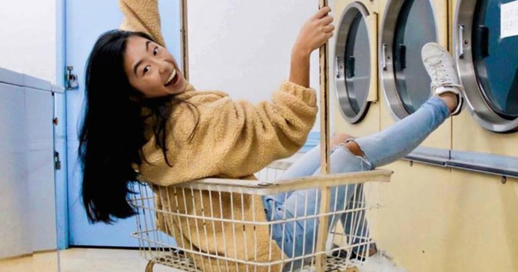 girl wearing hollister jeans in laundry basket