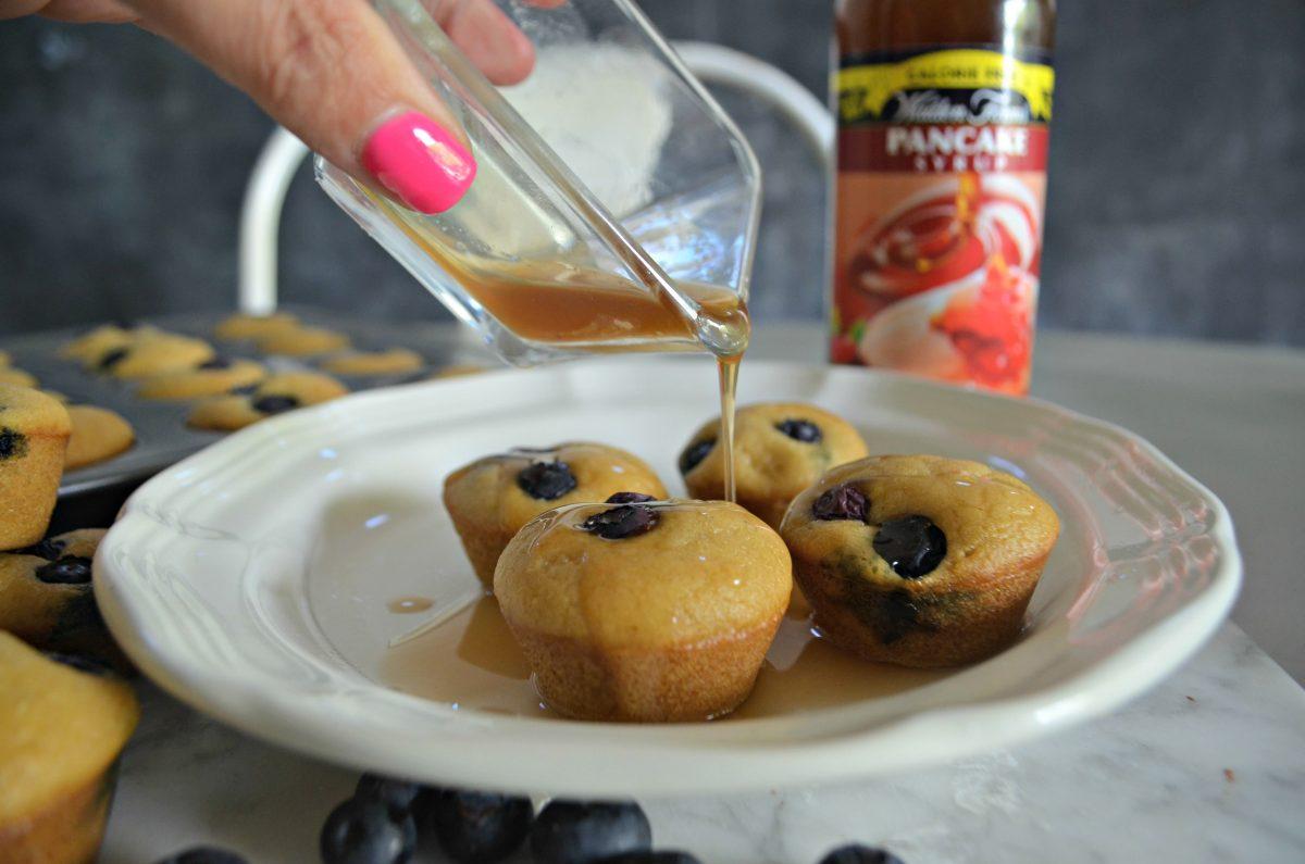mini pancake bites made keto – pouring sugar-free syrup over bites
