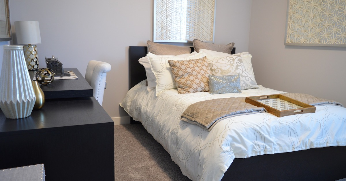 ways to have a great day in the morning – made bed in the master bedroom with pillows