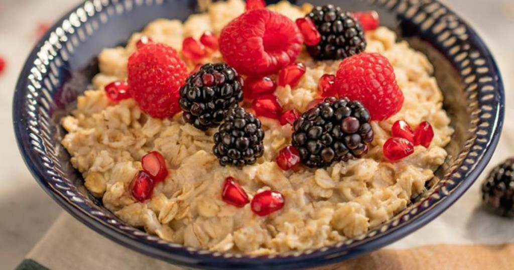 ways to have a great day in the morning - bowl of quaker oatmeal with berries on top