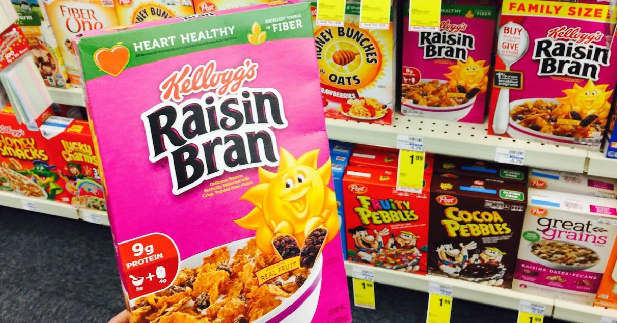 hand holding raisin bran cereal