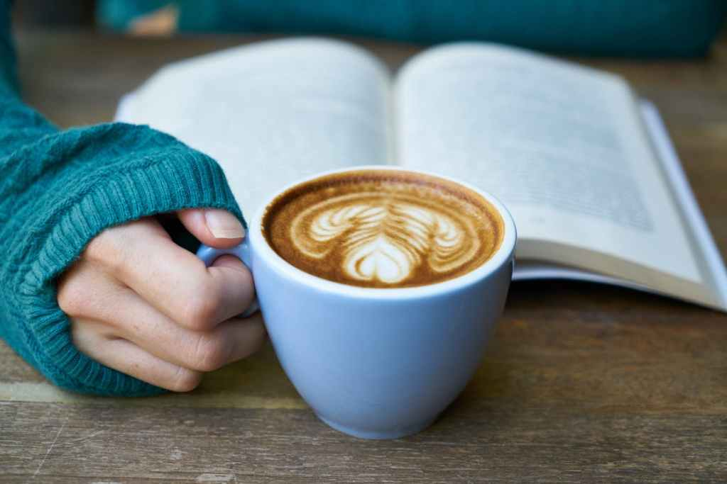 reading a book with coffee