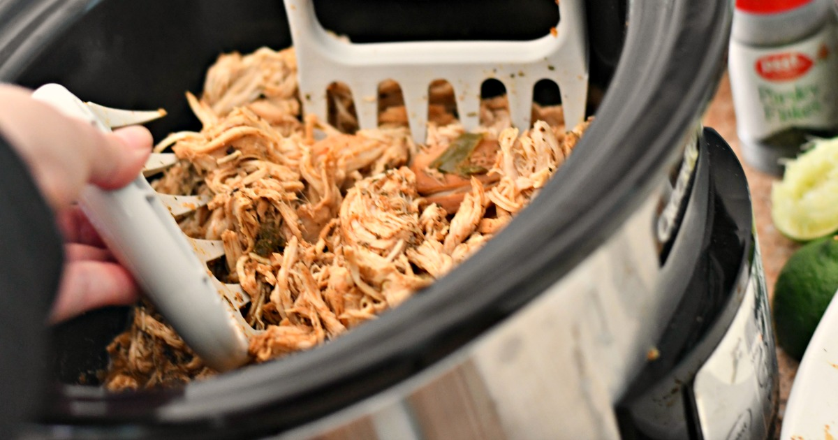 Slow Cooker Chicken Tacos being shredded apart