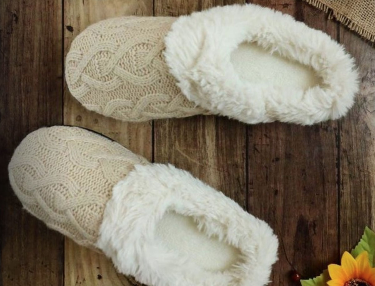 Isotoner slippers on a wood floor