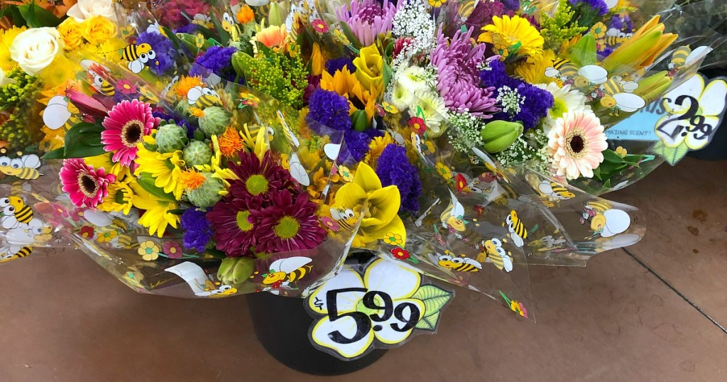 Display of brightly colored flowers at Trader Joe's for $5.99 a bouquet
