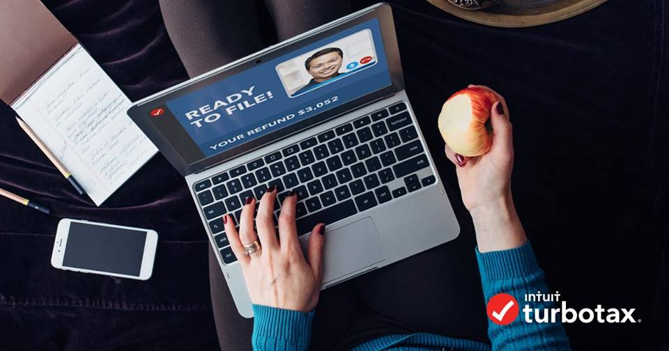 woman holding an apple and a laptop