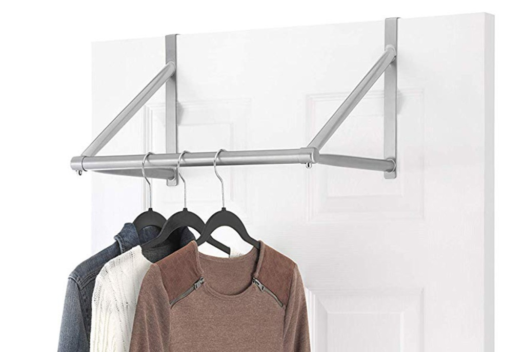 Whitmor Over The Door Metal Closet Rod on a door with shirts hanging from hangers