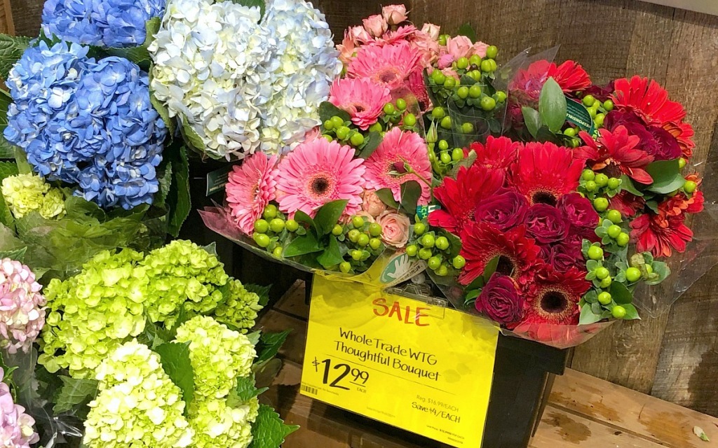 display of flower bouquets at whole foods on sale