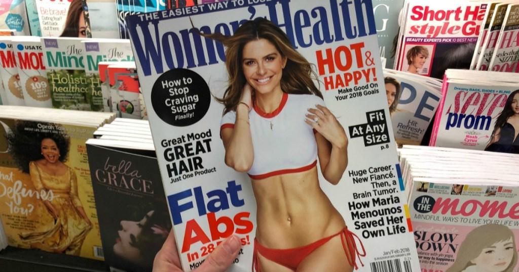 hand holding women's health magazine