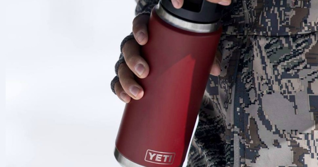 Person holding Yeti Red Rambler in hands