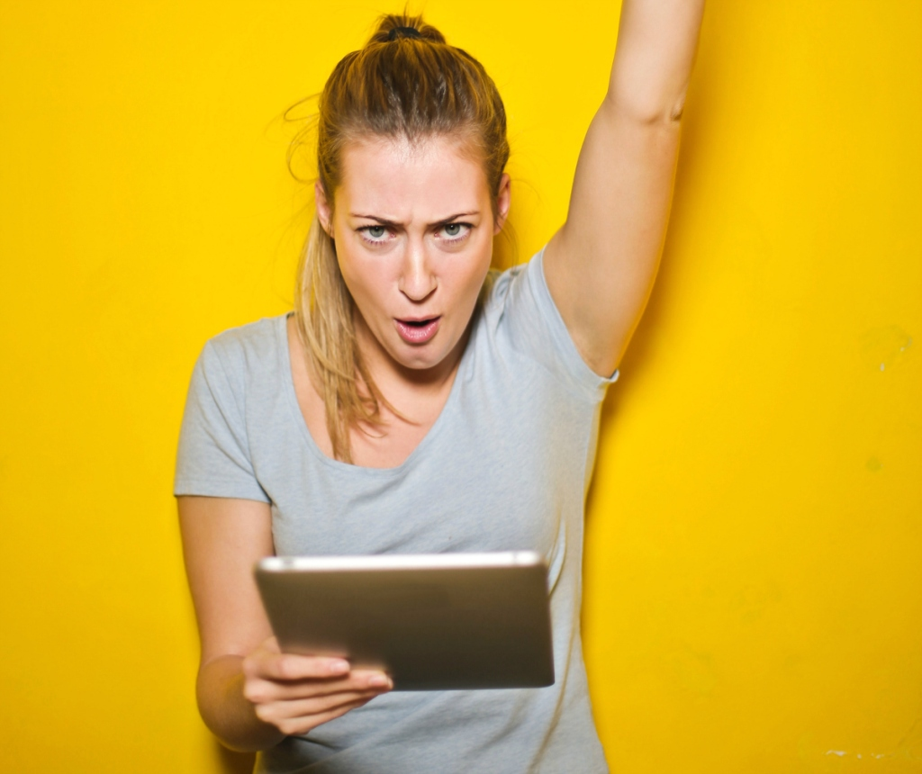 young woman happy with ipad