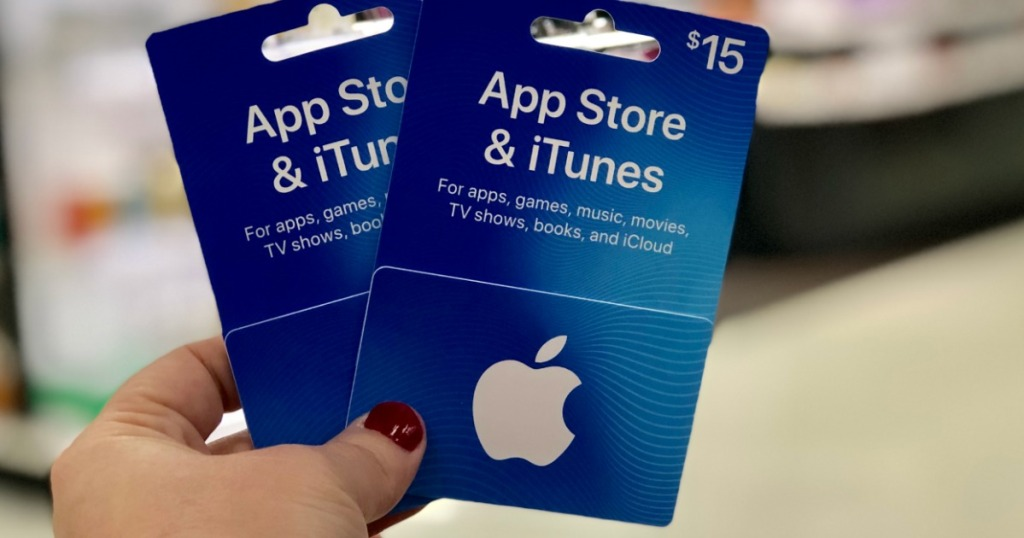 hand holding 2 itunes gift cards