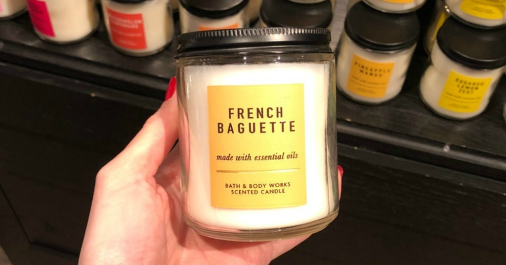 woman holding Bath & Body Works French Baguette Single Wick Candle