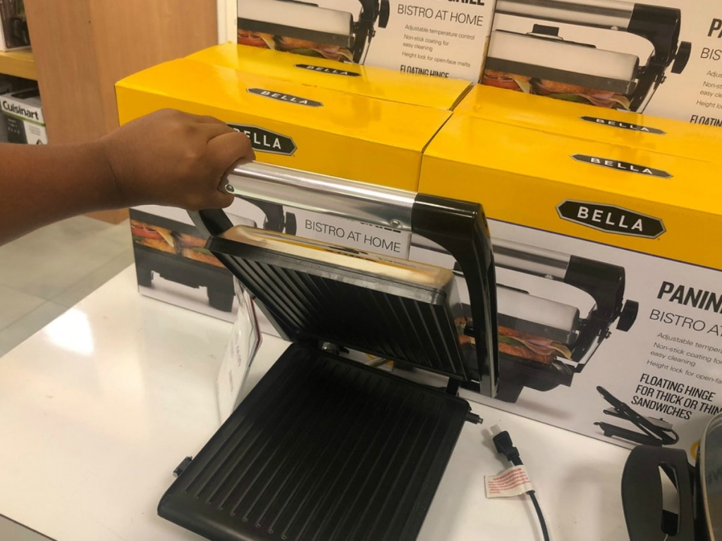 hand lifting up bella panini grill in store