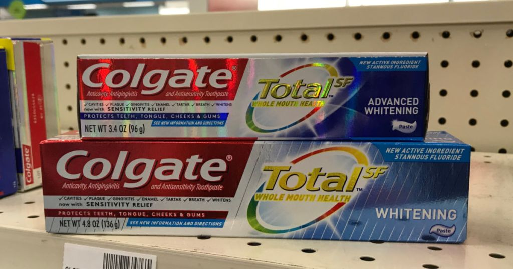 two boxes of colgate total toothpaste