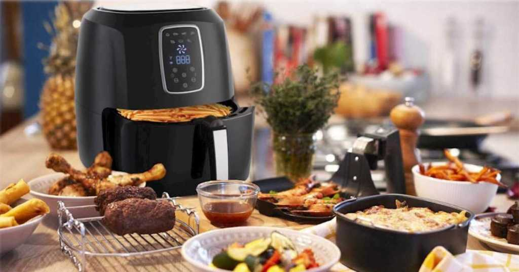 Air Fryer on counter with fried food surrounding it