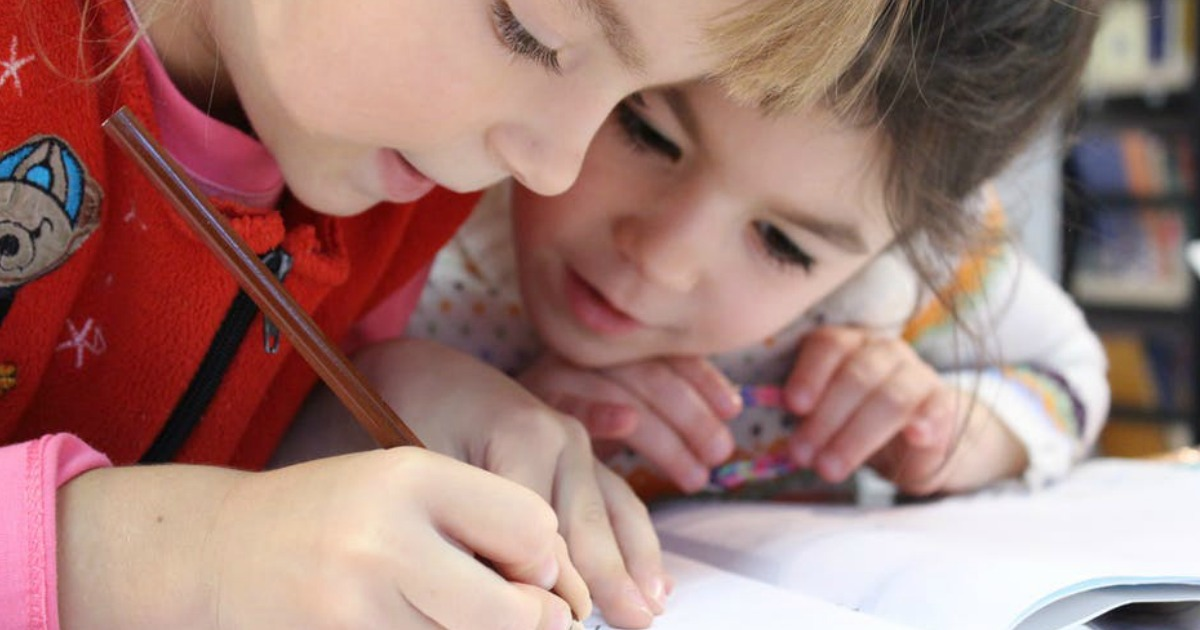 kids writing together