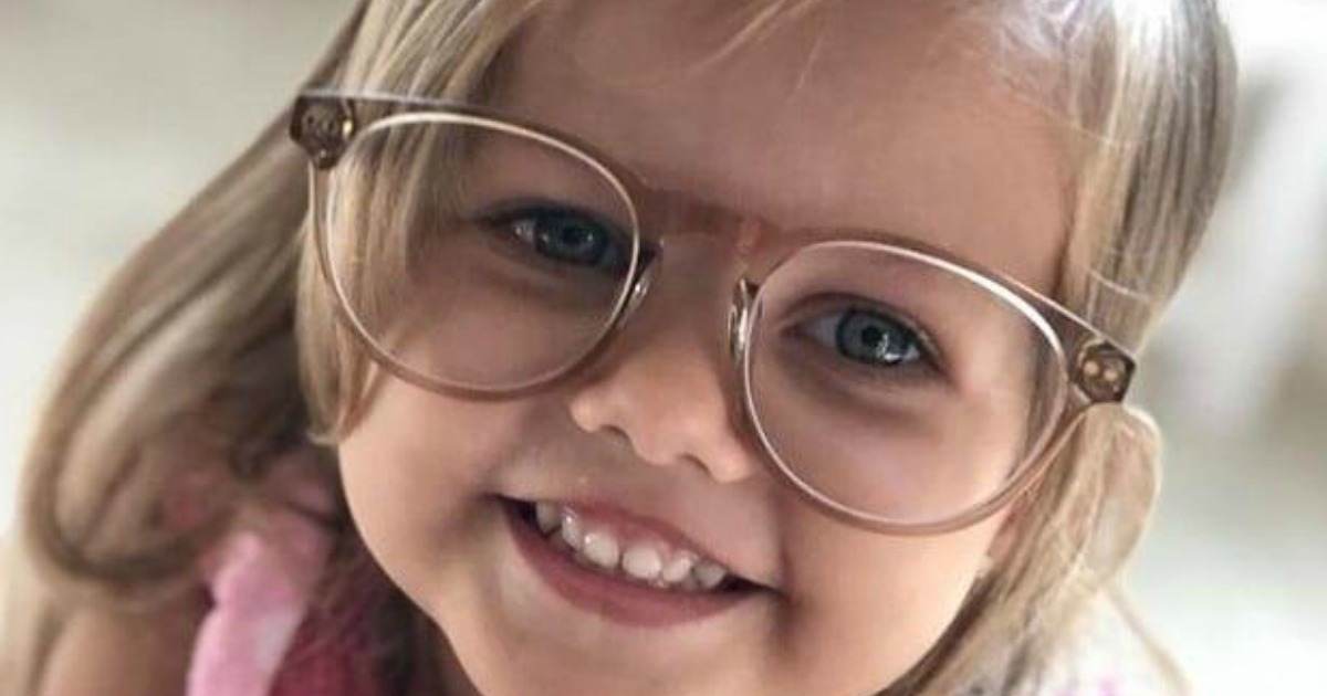 young smiling girl wearing glasses