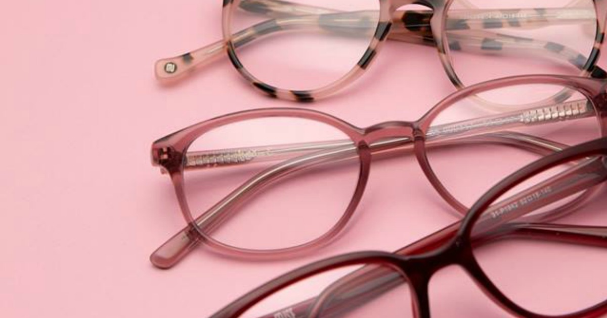 three pairs of glasses on a pink background