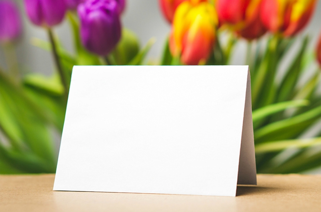 blank greeting card with flowers in background
