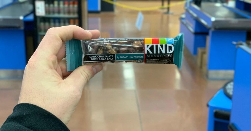 hand holding KIND Bars Dark Chocolate Nuts & Sea Salt
