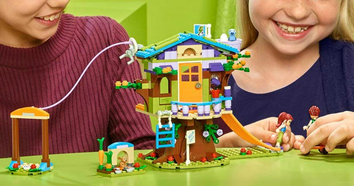 kids playing with LEGO tree house building set