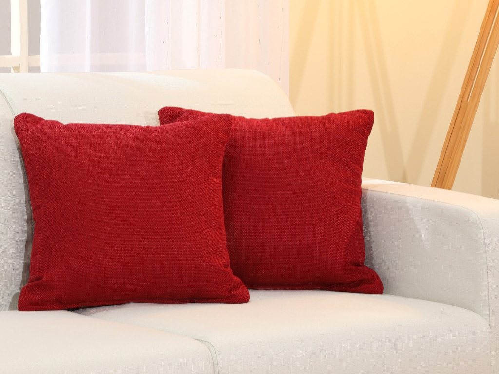 Red Mainstays Pillows on couch