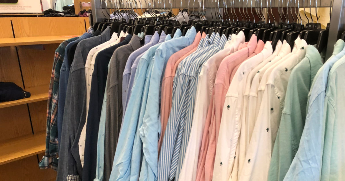Men's dress shirts hanging on rack