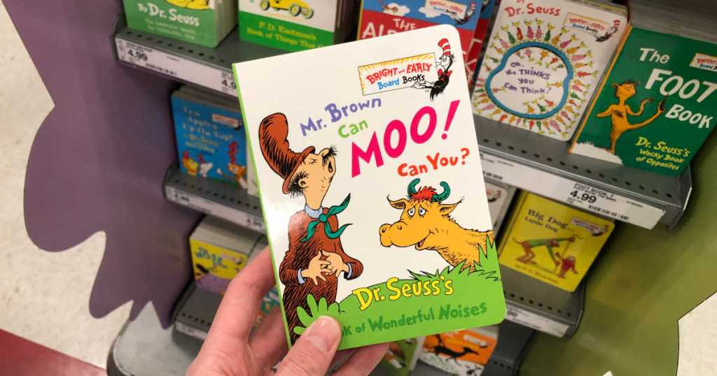 hand holding mr. brown can moo can you board book