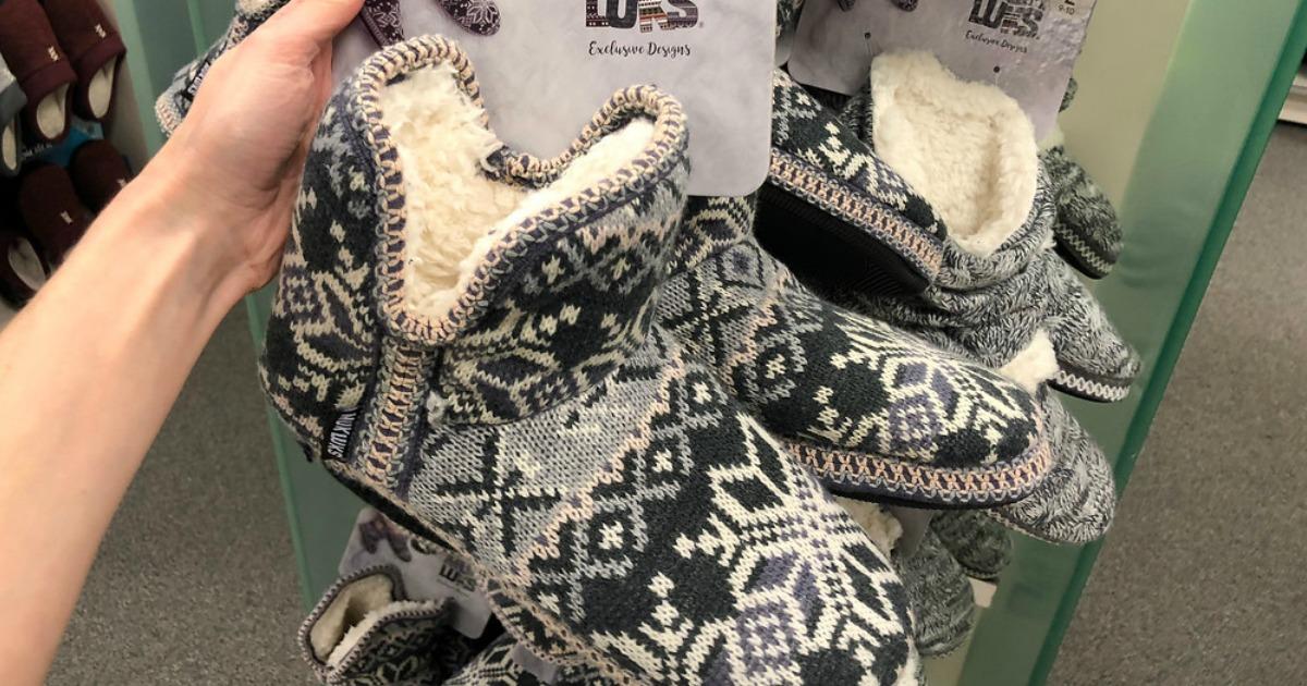 hand holding Muk Luks Boots