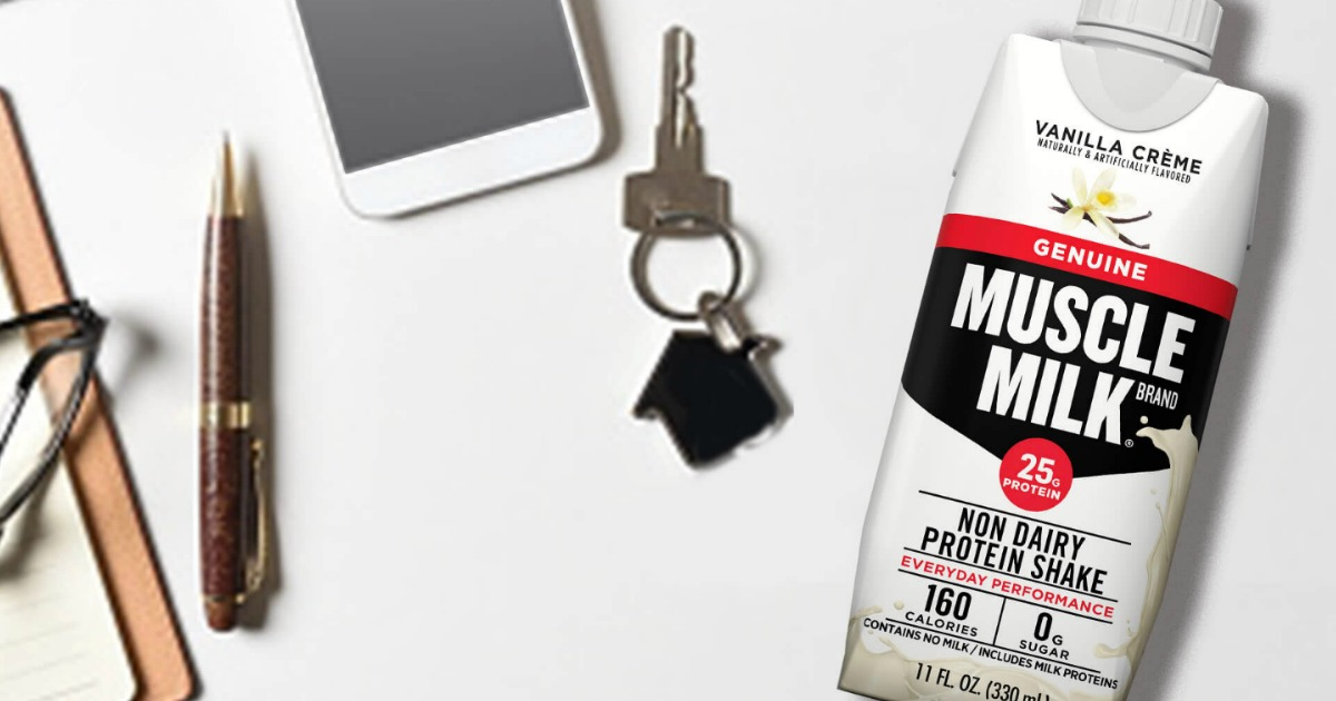 Muscle Milk VAnilla Creme with phone keys and pen nearby